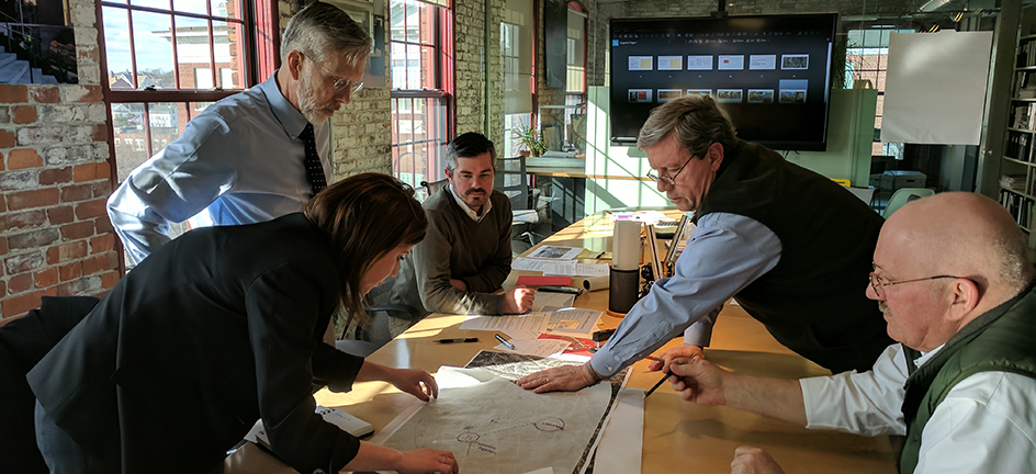 Collaborative project meeting with architects and clients